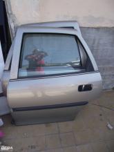 Opel Vectra B bal hátsó ajtó! Sedan! Pezsgő színű!Az ár a csupasz...